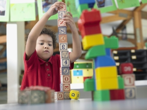 image - boy building with blocks